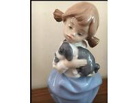 "NAO/LLADRO ""GIRL WITH SLEEPY PUPPY"" #1992 figurine"