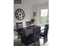 Black extendable high gloss dining table and 6 chairs