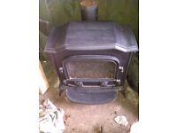 gas fire , gas stove ,looks like a woodburner