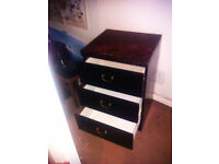 A PAIR OF LARGE THREE DRAWER BEDSIDE CABINETS