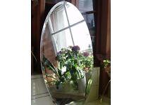 oval bevelled edge mirror 71 x 41 cm