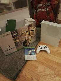 XBOX ONE S,couple weeks old,rechargeable battery pack one month ea access,Fifa17 on console