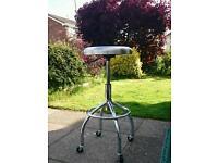 Stainless steel stool.