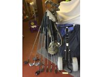 Golf bag,trolley and clubs.