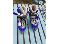 Blue inline skates for kids with protective gear
