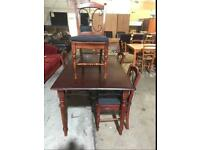 PRE-OWNED DARK WOOD WITH METAL DETAIL DINING TABLE WITH 4 CHAIRS - £80 In good condition