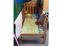 Wooden cot bed with waterproof mattress