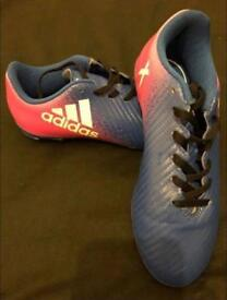2 pairs of Child's football boots - size 1