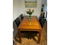 Extending dining table with 4 brand new leather chairs