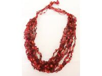 NEW. BEAUTIFUL & UNUSUAL KNITTED/CROCHETED NECKLACE. ORANGE