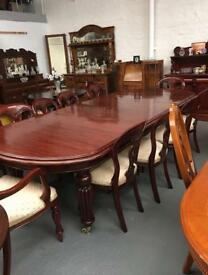 Stunning grand dining table & 10 chairs