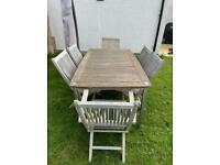 Teak outdoor table and six chairs