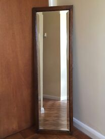 Full length mirror with bevelled glass and dark wood frame