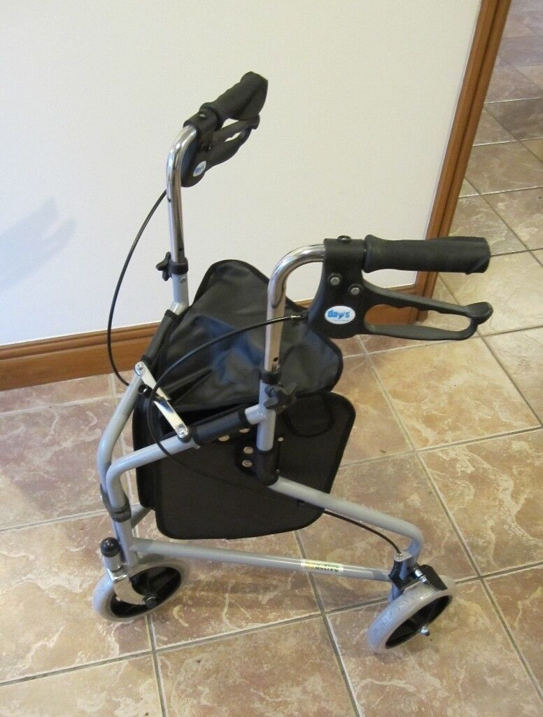 As new three wheel walker with brakes and bag - reduced