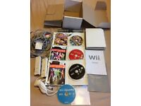 Ninetendo Wii Console with all instruction booklets, 2 controllers, sensor bar and 4 games.