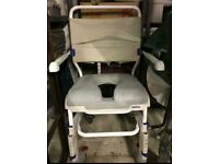 Shower commode chair by Invacare. DISABLED WHEELCHAIR TOILET USE