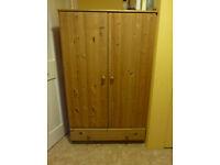 Unvarnished wood cabinet