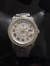 Woman's ROLEX iced out watch new.