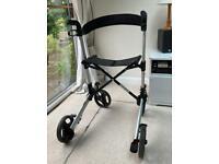 Folding 4 wheeled walking aid and seat