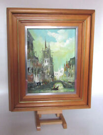Very decorative Early 1900's painting on canvas river with boat Venice Signed. Frame included.