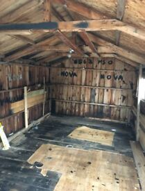 wooden garage 16 feet x 10 feet with electrics and windows