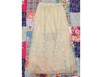Long skirt, see through off white fish cut