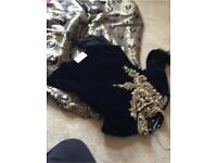 Black velvet top with gold embroidery and gold and black silky skirt