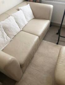 Cream leather sofa bed and matching poufee