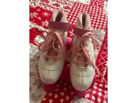 Girls size 4 pink and white roller skates.