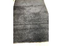 black rug size is 220x150 cm