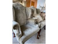 A pair of Antique Wing Chairs , recovered professionally at time of purchase .