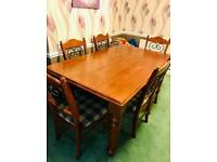 Large dining table with 6 chairs