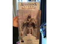 A variety of assassins creed collectible figures