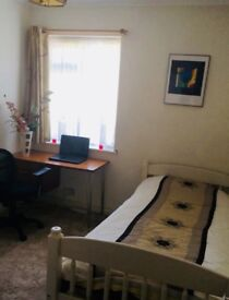 A bright furnished single room