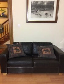 Brown leather sofa from John Lewis. Good condition.