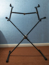 "Two Tier Keyboard Stand. Proel professional two-tier keyboard stand. ""SNAP LOCK"" adjustment system"