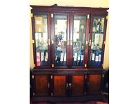 Magnificent display cabinet with intrigal spot lighting.