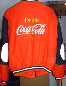 A NEW LEATHER AND WOOL COCA COLA JACKET SIZE FIT MEDIUM to LARGE