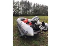 Inflatable dinghy with Suzuki 20 horse outboard