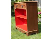 Bookcase with 2 shelves and 2 drawers in mid oak and a bright red interior