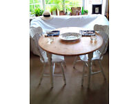 Farmhouse Rustic Shabby Chic Round Table and Two Chairs with Carved Details.