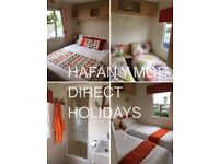 Static caravan haven, Hafan y Mor, for hire. Choice of 2, 3 bedroomed with heating & decking