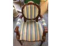 Antique style wooden chair with fabric seating