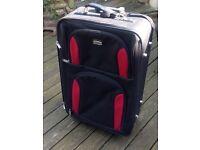 SKYFLITE Soft Body Canvas Suitcase On Travel Wheels