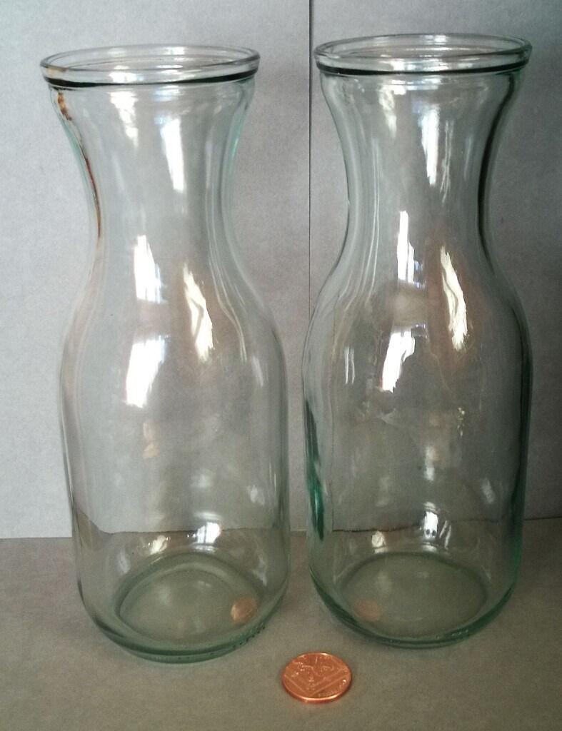 large bottle style glass vasesin St Helens, MerseysideGumtree - large bottle style glass vases large bottle style glass vases 2 nice vases,in great condition.see images for details