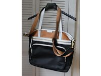 Beautiful Fossil handbag/tote in black, tan and white.