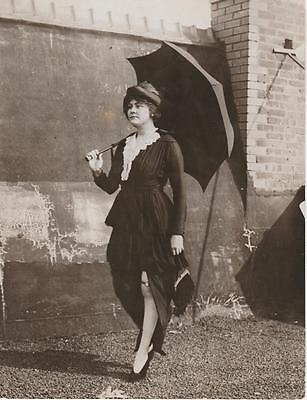 Fashionable 1900s woman with watch garter vintage still