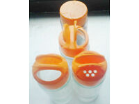 4 New Clear Glass EMPTY Refillable Spice Jars with Orange Lidded Sprinkler Tops.