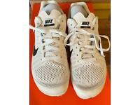 Nike running shoes with spikes size 3.5