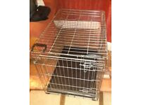 Double door dog cage door opens both ways and has two carry handles size H51 W60 D44cm